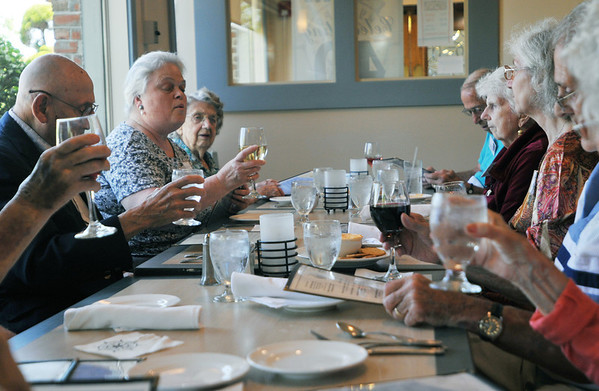Danvers: A blessing and toast began the celebration of the Danvers High School Class of 1936 gathered for their 75th reunion.   photo by Mark Teiwes / Salem News