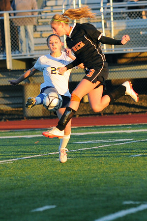 Lynn: Ipswich's Mariah Brockelbank volleys the ball during Thursday's division 3 north semifinals.  Ipswich won the match over Lynnfield in a shootout after two overtime periods. photo by Mark Teiwes / Salem News