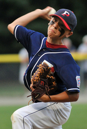 Beverly: Peabody West pitcher fiercely puts a pitch into play.  Mark Teiwes / Salem News
