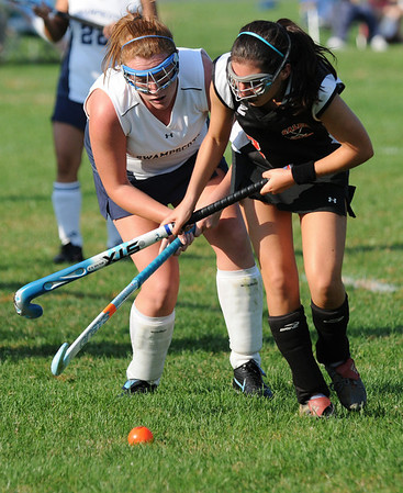 Swampscott: Salem's Toni Randazzo, right, keeps possession of the ball with Swampscott's Jenn Desmond close behind.  photo by Mark Teiwes / Salem News