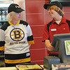 Middleton: Judy McNiff, left, the principal at the Burke School in Peabody helps out Middleton McDonald's employee David Dimauro during a fundraiser to benefit the school which raised $450.  photo by Mark Teiwes / Salem News
