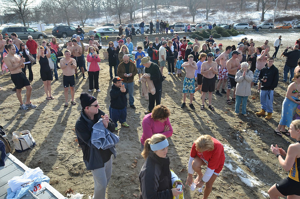 "Salem: Participants take part in the second annual ""Freeze Your Tush Off"" ocean dip at Dead Horse Beach.   photo by Mark Teiwes  / Salem News"