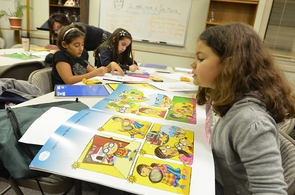 Peabody: 7-year-old Victoria Marques, right, practices Portuguese during a class at Our Lady of Fatima Church. photo by Mark Teiwes / Salem News