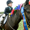 Hamilton:  Olivia Parrott, 5, of Hamilton shows off a pony named Monkey prior to the start of the Putnam Boston Jumper Classic.   photo by Mark Teiwes / Salem News