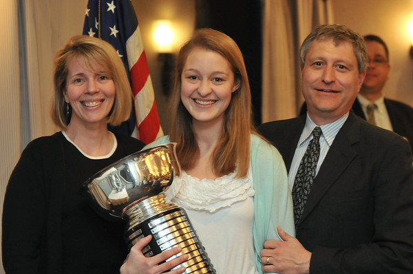 Danvers: The 49th annual Salem News Student-Athlete Award winner  Olivia Raisner of Marblehead High School stands with her parents Bruce and Carolyn.  photo by Mark Teiwes / Salem News