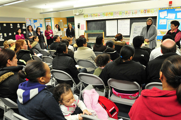 Salem: ESL teacher Letty Deleon, right, and principal Nancy Pelletier address parents of children who are English language learners.    photo by Mark Teiwes / Salem News