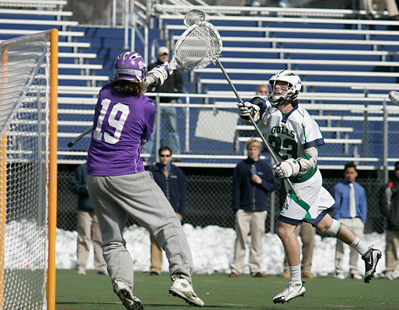 Beverly: Endicott defenseman Kyle Burke, right, made his way accross the the field to score on Curry goalie Michael Hibbard. photo by Mark Teiwes / Salem News