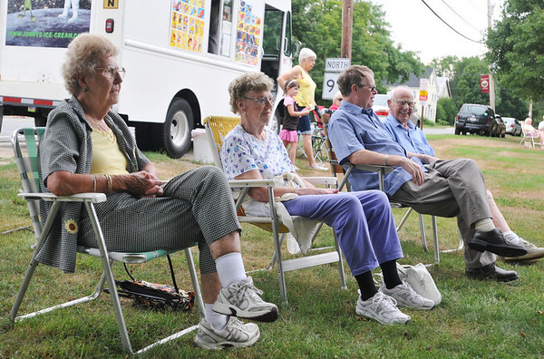 Topsfield:  Lynne Dwinell, left, Ruth and John Ingalls and Ed Libby brought their lawn chairs to lounge on Topsfield Common during a Sunday concert.  photo by Mark Teiwes / Salem News