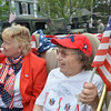 Danvers: Jan Tipert, left, and Betty Clay, cruise in a convertible with the Daughters of the American Revolution for the memorial day parade in Danvers.  photo by Mark Teiwes / Salem News