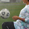 Peabody:  Kristin Verrette juggles the ball during a team training in the rain on Friday.