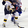 Peabody: Bishop Fenwick's Jake Brennan skates around Swampscott's Robert Serino. photo by Mark Teiwes / Salem News