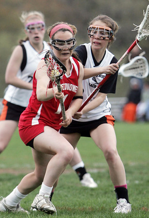 Ipswich:  Masconomet girls varsity lacrosse captain Courtney Cliffe carries the ball upfield.  Mark Teiwes / Salem News