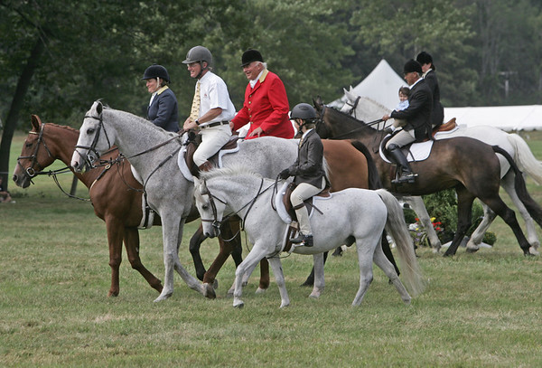 Hamilton: The Little, left, and Tissera families ride during the family class of the 111th Annual Myopia Horse Show.  photo by Mark Teiwes  / Salem News