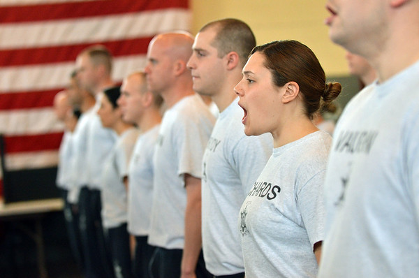 Danvers: Jacquelin Richards yells out for a roll call at the end of a day of jail guard training.  photo by Mark Teiwes / Salem News
