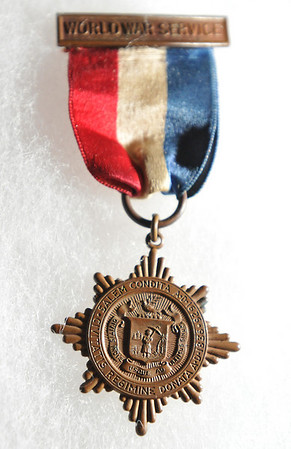 Salem:  The medal from World War I includes the seal of the city of Salem.  It was originally presented to Emile Thibault for world war service in 1917-1918.   photo by Mark Teiwes / Salem News