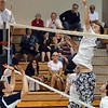 Danvers: St. John's Prep player Robbie Clough leaps for a spike.  photo by Mark Teiwes / Salem News