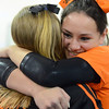 Middleton: Beverly's Taylor Metta gets a hug from her teammate after hearing the team's winning score.    photo by Mark Teiwes  / Salem News