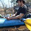 Middleton: Corey Batchelder of Peabody preps to kayak down the Ipswich river with his dog Chebacca and a friend.   photo by Mark Teiwes / Salem News
