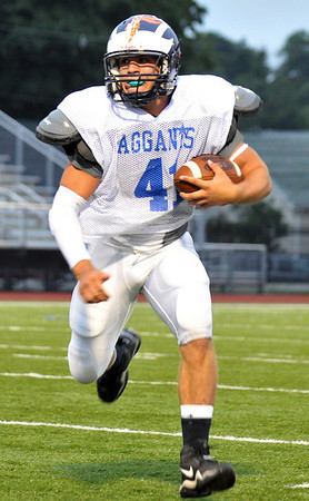 Lynn: Swampscott's Kyle Shonio makes a run with the ball at the 49th annual Agganis All-Staff Football Classic.  photo by Mark Teiwes / Salem News