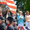 Swampscott: North Shore Gold Star families, family members of a person who died in the armed forces, gathered to watch the Veterans Appreciation Day parade in Swampscott.  From left, James and Christina Ayube of Salem, in honor of their son James was killed last year in Afghanistan; and Andrew Wilson, Agnes Raymond and Jacki Raymond of Swampscott, remembering Jared Raymond who was killed in Iraq in 2006.     photo by Mark Teiwes / Salem News