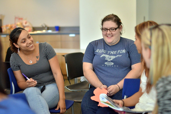 Salem:  Salem State University students Brittany Perez, left, and Emma Gelinas participate in a group discussion during a training for  student support staff at the start of a new academic year. photo by Mark Teiwes / Salem News