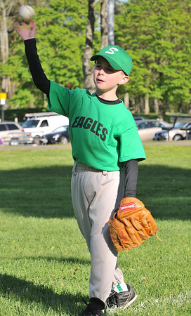 Salem: First baseman Kevin Rush, 8, tosses the ball.  photo by Mark Teiwes / Salem News