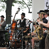 Salem:  Band leader Chuck Lechien Jr. of Somerville, right, plays with Emperor Norton's Stationary Marching Band.  Although the band was not a typical jazz band festival crowd was highly entertained.    photo by Mark Teiwes / Salem News