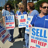 Beverly:  Union registered nurses from Beverly Hospital, Paula Musticchio, left, Joanne Lund, Mariann Cleary, Diane Hickey, and Pam St. Pierre picket outside the hospital. The nurses say hospital management will not guarantee that a new owner will honor their contract when the hospital is sold.  photo by Mark Teiwes / Salem News