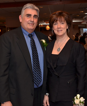 Danvers: Ron and Colette Hennessey were honored at the Danvers Educational Enrichment Partnership's annual hall of honor fundraiser  photo by Mark Teiwes / Salem News