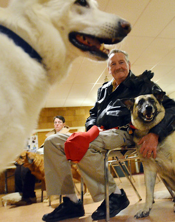 Danvers: Len Bruyette of Middleton sits with Nibbles, a german shepherd he adopted that served in the Iraq War. photo by Mark Teiwes / Salem News