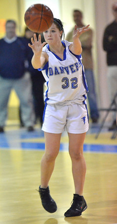 Danvers: Danvers Kasey Sherry dishes off a pass during last night's game against Revere.   photo by Mark Teiwes  / Salem News