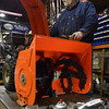 Peabody: Paul Hincman, owner of Outdoor Power Equipment in Peabody, works on a snowblower at his shop. photo by Mark Teiwes / Salem News