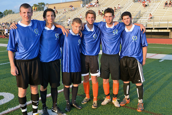 Lynn: Derek Shleer, left, of Masconomet, Clifford McKeon of Peabody High School, Luke Finkelstein of Peabody High School, Matt Bourque of Beverly High School, Josh Carmer of Beverly High School, and Danny McCarthy of Salem High School joined forces to play for the north team in the Agganis All-Star Men's soccer classic.    photo by Mark Teiwes  / Salem News