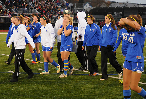 Lynn: A shocked Danvers girls soccer team reacts after losing to Belmont in a shootout after two overtime periods in the  Division 2 North finals. photo by Mark Teiwes / Salem News