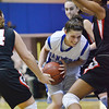 Danvers:  Danvers Sarah Palazola struggles to get to the hoop closely covered by Salem defense.  photo by Mark Teiwes / Salem News