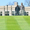 Salem:  John Eggleston, Kernwood Country Club grounds superintendent, and Frand Dully, head golf professional, stand on the green of the course's 18th hole.  photo by Mark Teiwes / Salem News