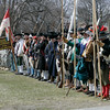 Salem: Salem Trayned Band, right, a group that re-enacts the 17th century  Salem militia, lines up with other reneactment groups and members of the 101st Field Artillery Regiment.  photo by Mark Teiwes / Salem News