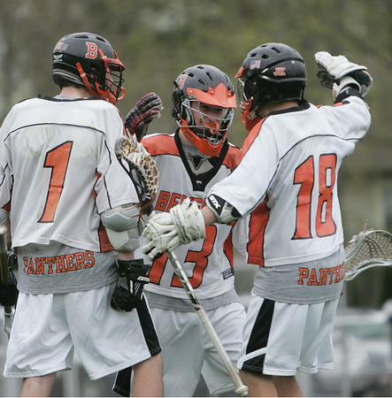 Beverly: Beverly's Tony walsh, left, Max Gansenberg, and Alex Traicoff celebrate a goal scored.   photo by Mark Teiwes