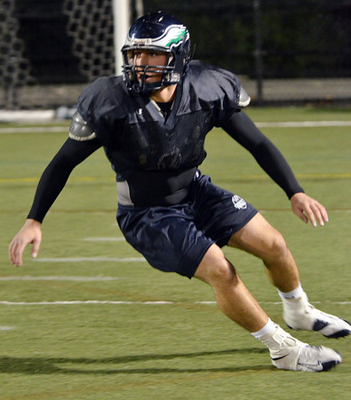 Beverly: Peter Kallas, an Endicott linebacker from Beverly, makes a cut across the field as he prepares for Saturday's NCAA Division 3 playoff game.  photo by Mark Teiwes / Salem News