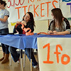 Peabody: Peabody High School seniors Charlene Swain, left, Rebecca Belleau, and Brienna Griffin sell tickets for 50-50 and gift basket  raffles during a fundraiser for the school's senior class. photo by Mark Teiwes / Salem News