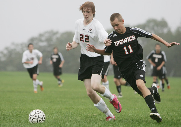 Beverly: Beverly's Mac Gotsch, left, goes should to shoulder with Ipswich player Ryan Law.   photo by Mark Teiwes  / Salem News