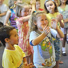 Salem: Quinn Ryan, 4, left, claps with his sister Brooke, 6, of Salem at a Salem Public Library children's program.  photo by Mark Teiwes /  Salem News