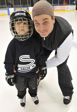 Salem: Joseph McGonagle of Swampscott skates with his son Jake, 5.  photo by Mark Teiwes / Salem News