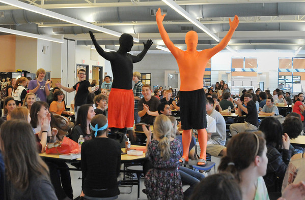 Beverly: Jake Levine, left, and Cam Jones, Beverly High School sutdents, dress in head to toe spandex to encourage school spirit for football games.     photo by Mark Teiwes / Salem News