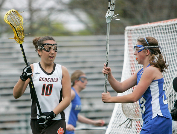 Beverly: Beverly's Camden Vitale, left, looks for a pass watched by  Rachel Trocchi of Danvers  photo by Mark Teiwes
