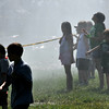 Marblehead:   Kids enjoy the mist from fire hose spray at the Firemen's Muster at Reynolds Field.   photo by Mark Teiwes / Salem News
