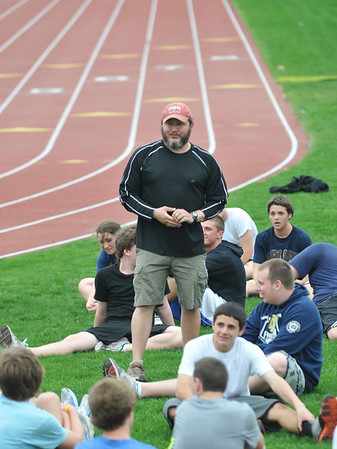 Peabody: Bishop Fenwick is hosting the Division 4 state relay meet for the first time on Sunday. Jay Smith, center, and his staff have been busy preparing for the 28 boys teams and 28 girls teams that will be attending..  photo by Mark Teiwes
