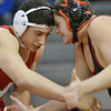 Topsfield: Masconomet's Nick DiLibero, left, goes head-to-head with Salem's Andrew Romeo in the 215 pound division.  DiLibero won on a pin. photo by Mark Teiwes  / Salem News