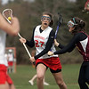 Topsfield: Masconomet's Brynn Wendel, left, drives on her way to score on Newburyport.   photo by Mark Teiwes / Salem News