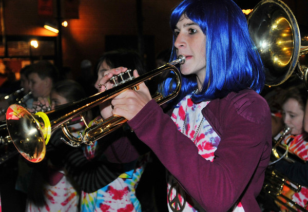Salem:  Dal Embick plays the trumpet with the Collins School for the Haunted Happenings Grand Parade. Mark Teiwes / Salem News